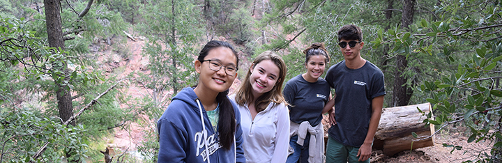 students at a leadership camp in the forest